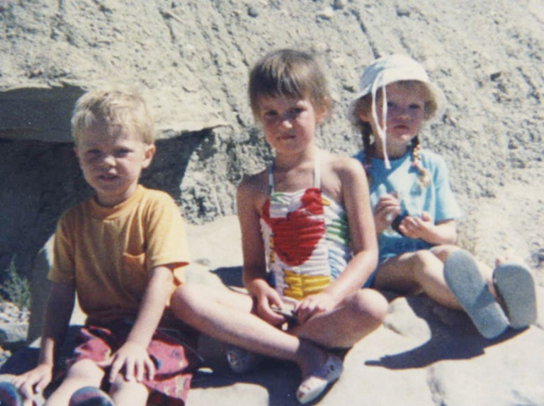 Me as a little human at the lake with family friends--I promise we were having way more fun than it may appear in this photo.
