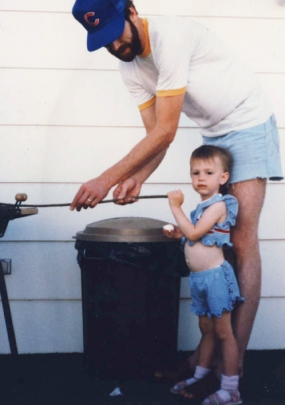 Me as a little human with my dad making s'mores.