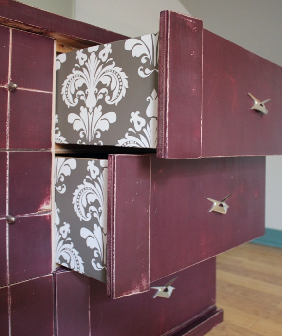 I used a contact-paper style wallpaper on the sides of the drawers.  I thought it was a fun accent.