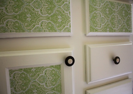 Green damask contact paper on the cabinets, because it looks fun.